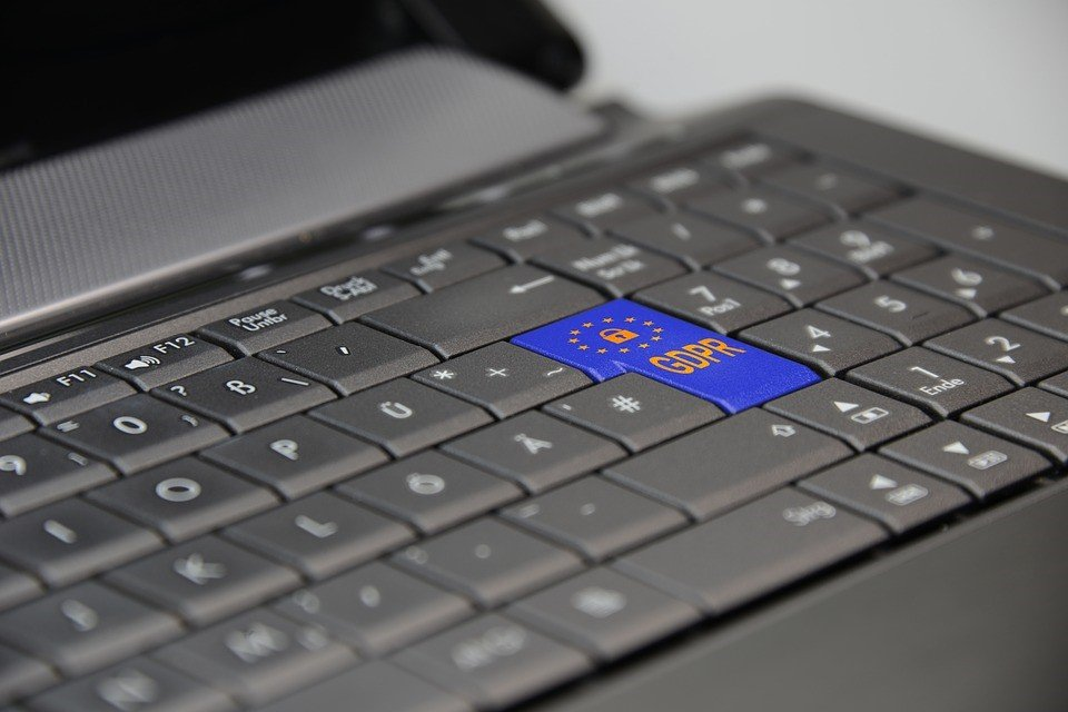 Laptop keyboard with a blue GDPR key in place of the enter key.